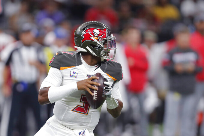 Tampa Bay Buccaneers quarterback Jameis Winston (3) drops back to pass in the first half of an NFL football game against the New Orleans Saints in New Orleans, Sunday, Oct. 6, 2019. (AP Photo/Gerald Herbert)