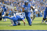 Kentucky running back Benny Snell Jr. (26) runs for a touchdown during the first half of an NCAA college football game against Middle Tennessee in Lexington, Ky., Saturday, Nov. 17, 2018. (AP Photo/Bryan Woolston)