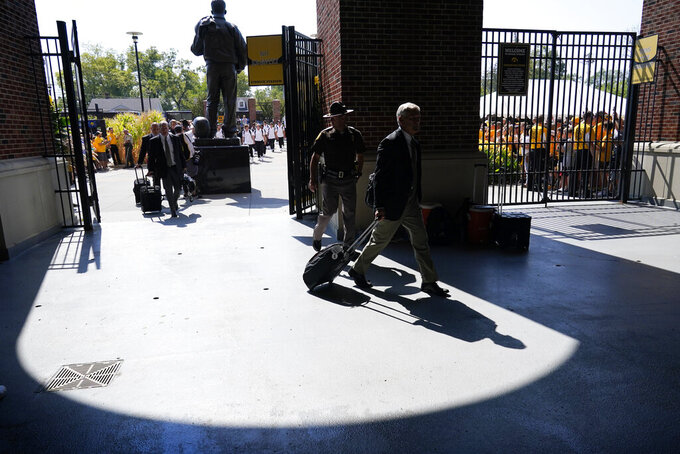 Iowa head coach Kirk Ferentz arrives at Kinnick Stadium before an NCAA college football game against Kent State, Saturday, Sept. 18, 2021, in Iowa City, Iowa. (AP Photo/Charlie Neibergall)