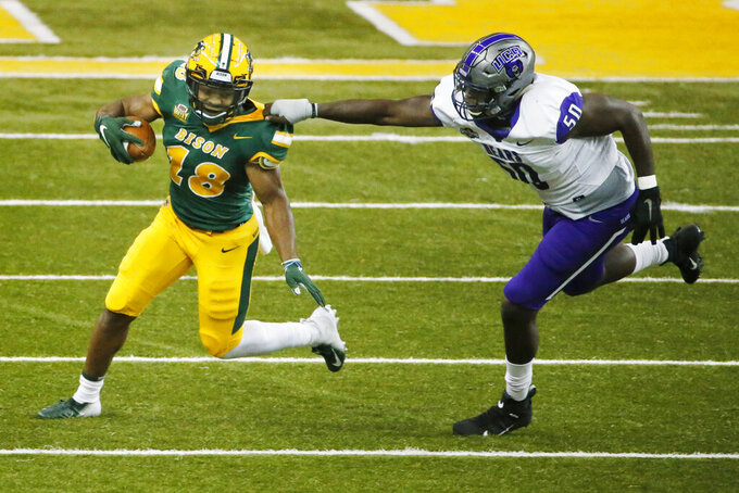 Central Arkansas defensive end J.W. Jones (50) pulls down North Dakota State running back Adam Cofield (18) in the first quarter of an NCAA college football game Saturday, Oct. 3, 2020, in Fargo, N.D. (AP Photo/Bruce Kluckhohn)