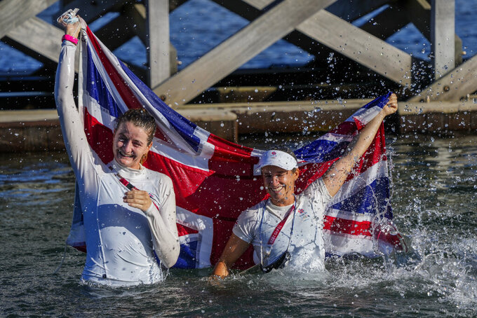 Britain's Hanna Mills, right, and Eilidh Mcintyre celebrate after winning the 470 women's gold medal during the 2020 Summer Olympics, Wednesday, Aug. 4, 2021, in Fujisawa, Japan. (AP Photo/Bernat Armangue)