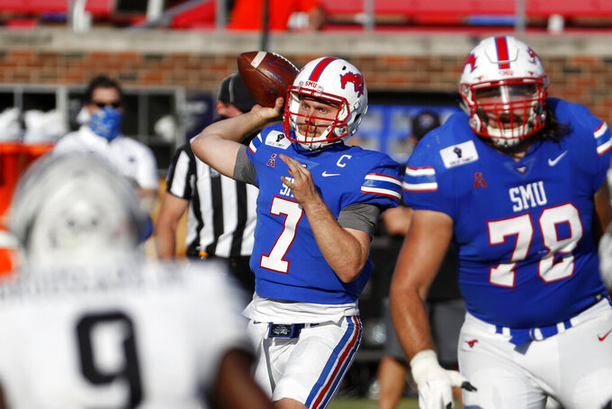 SMU quarterback Shane Buechele (7) throws a pass during the second half of an NCAA college football game against Memphis in Dallas, Saturday, Oct. 3, 2020. (AP Photo/Roger Steinman)