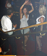 In this June 2009 photo made available to the Associated Press on Friday Oct. 5, 2018, soccer star Cristiano Ronaldo is pictured with Kathryn Mayorga, center, in Rain Nightclub in Las Vegas. A lawyer for Mayorga, who is alleging that Ronaldo raped her in Las Vegas in 2009 said her client was