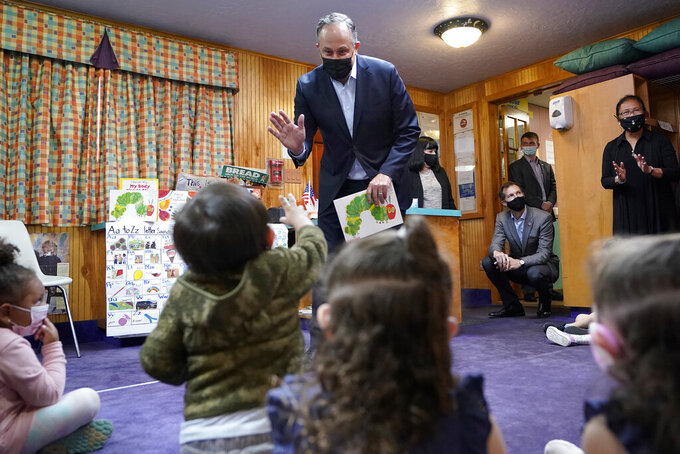 Douglas Emhoff, husband of Vice President Kamala Harris, top, greets pre-school children before reading The Very Hungry Caterpillar, by Eric Carle, at Mother Hubbard Pre-School Center, Monday, Sept. 20, 2021, in Milford, Mass. Emhoff visited the child care center to draw attention to the Biden administration's Build Back Better agenda. (AP Photo/Steven Senne)
