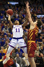 Kansas guard Devon Dotson (11) shoots while covered by Iowa State forward Michael Jacobson (12) during the first half of an NCAA college basketball game in Lawrence, Kan., Monday, Jan. 21, 2019. (AP Photo/Orlin Wagner)