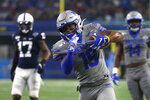 Memphis running back Kenneth Gainwell (19) carries the ball against the Penn State in the first half of the NCAA Cotton Bowl college football game, Saturday, Dec. 28, 2019, in Arlington, Texas. (AP Photo/Ron Jenkins)