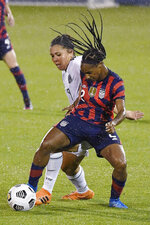 United States' Crystal Dunn, right, keeps the ball from Mexico's Kiana Palacios during the second half of an international friendly soccer match Thursday, July 1, 2021, in East Hartford, Conn. (AP Photo/Jessica Hill)