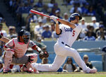 Los Angeles Dodgers' Corey Seager follows through on his grand slam home run against the Washington Nationals during the eighth inning of a baseball game Sunday, May 12, 2019, in Los Angeles. (AP Photo/Marcio Jose Sanchez)