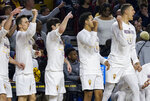 Arizona State players on the bench cheer on their team during the first half of an NCAA college basketball game against Oregon, Saturday, Jan. 19, 2019, in Tempe, Ariz. (AP Photo/Darryl Webb)