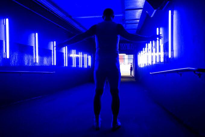 SMU quarterback Shane Buechele warms up in the tunnel before an NCAA college football game against Cincinnati, Saturday, Oct. 24, 2020, in Dallas. (AP Photo/Jeffrey McWhorter)