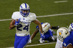 Air Force running back Kadin Remsberg (24) runs against San Jose State during the first half of an NCAA college football game in San Jose, Calif., Saturday, Oct. 24, 2020. (AP Photo/Jeff Chiu)