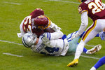 Dallas Cowboys quarterback Andy Dalton (14) is hit by Washington Football Team inside linebacker Jon Bostic (53) in the second half of an NFL football game, Sunday, Oct. 25, 2020, in Landover, Md. Dalton left the field after this hit and Bostic was ejected from the game. (AP Photo/Patrick Semansky)