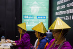 Chinese women try out a pyramid-shaped device purported to improve blood circulation in the brain during the 21st China Beijing International High-tech Expo in Beijing, China, Thursday, May 17, 2018. The annual exhibition is a showcase of China's state-of-the-art technologies and cutting-edge ideas. (AP Photo/Ng Han Guan)