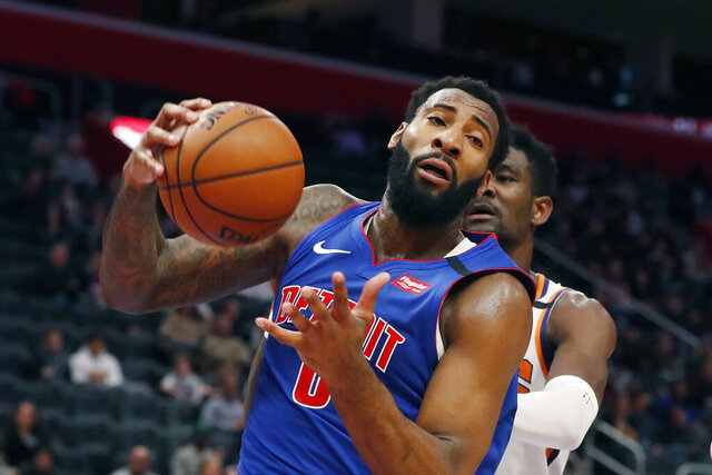 Detroit Pistons center Andre Drummond pulls down a rebound during the second half of an NBA basketball game against the Phoenix Suns, Wednesday, Feb. 5, 2020, in Detroit. (AP Photo/Carlos Osorio)