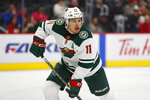 "FILE - In this Feb. 27, 2020, file photo, Minnesota Wild left wing Zach Parise (11) plays against the Detroit Red Wings in the first period of an NHL hockey game in Detroit. For all the wealth, privilege and rewards elite sports can provide its participants, few vocations require more time away from loved ones. The NHL season has been called off because of the pandemic. ""My 2-year-old gets up at about 5 in the morning,"" Minnesota Wild forward Zach Parise said. ""He naps from like 1 to 3, and that's our time to take a deep breath."" Parise and his wife, Alisha, also have 6-year-old twins to look after.(AP Photo/Paul Sancya, File)"