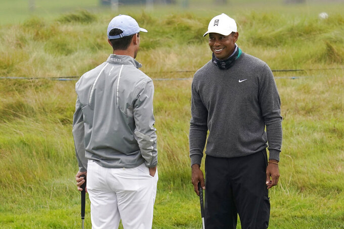 Tiger Woods, right, smiles while talking to Billy Horschel during practice for the PGA Championship golf tournament at TPC Harding Park in San Francisco, Tuesday, Aug. 4, 2020. (AP Photo/Jeff Chiu)