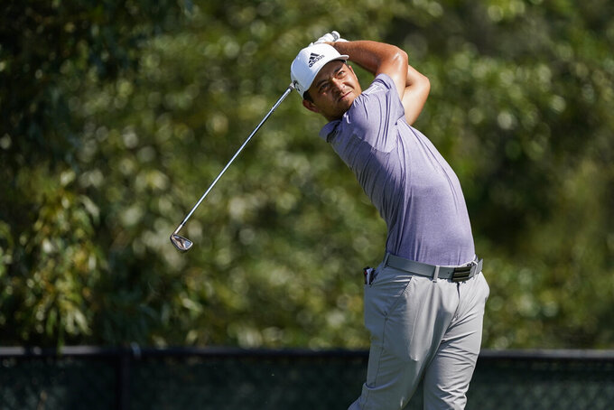 Scottie Scheffler hits his tee shot on the third hole during the third round of the Tour Championship golf tournament at East Lake Golf Club in Atlanta, Sunday, Sept. 6, 2020. (AP Photo/John Bazemore)