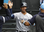 New York Yankees' Gleyber Torres celebrates with teammates after scoring on a one-run single by Brett Gardner during the eighth inning of a baseball game against the Chicago White Sox in Chicago, Sunday, June 16, 2019. The Yankees won 10-3. (AP Photo/Nam Y. Huh)
