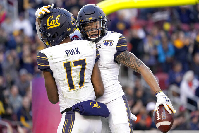California wide receiver Nikko Remigio, right, celebrates with Makai Polk (17) after scoring a touchdown against Illinois during the second half of the Redbox Bowl NCAA college football game Monday, Dec. 30, 2019, in Santa Clara, Calif. (AP Photo/Tony Avelar)