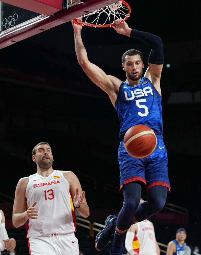 United States' Zachary Lavine (5), right, scores over Spain's Marc Gasol (13) during men's basketball quarterfinal game at the 2020 Summer Olympics, Tuesday, Aug. 3, 2021, in Saitama, Japan. (AP Photo/Eric Gay)