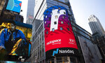Cloud computing company Rackspace begins trading at the Nasdaq following its initial public offering, Wednesday, Aug. 5, 2020, in New York's Times Square. (AP Photo/Mark Lennihan)