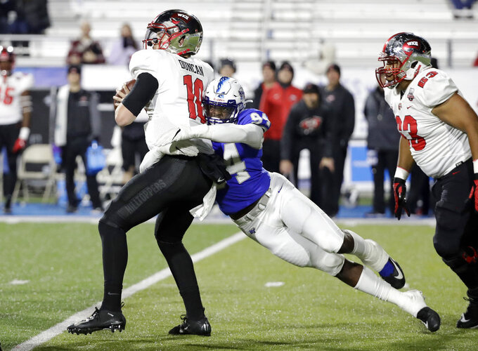 Middle Tennessee defensive end Tyshun Render (94) sacks Western Kentucky quarterback Steven Duncan (10) for a 7-yard loss during the second half of an NCAA college football game Friday, Nov. 2, 2018, in Murfreesboro, Tenn. Middle Tennessee won 29-10. (AP Photo/Mark Humphrey)