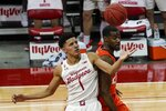 Wisconsin's Jonathan Davis and Illinois's Kofi Cockburn go after a loose ball during the first half of an NCAA college basketball game Saturday, Feb. 27, 2021, in Madison, Wis. (AP Photo/Morry Gash)