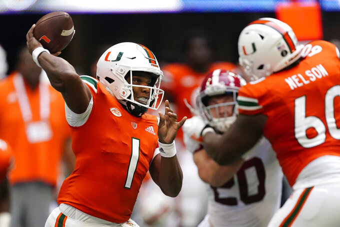 Miami quarterback D'Eriq King (1) throws from the pocket during the first half of an NCAA college football game against Alabama, Saturday, Sept. 4, 2021, in Atlanta. (AP Photo/John Bazemore)