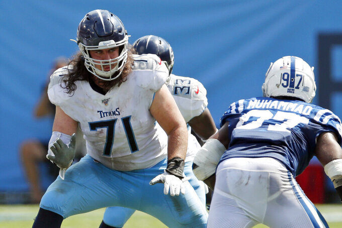FILE - In this Sept. 15, 2019, file photo, Tennessee Titans offensive tackle Dennis Kelly (71) set to block against the Indianapolis Colts during an NFL football game in Nashville, Tenn. Kelly has been hunkered down with his family in the Indianapolis area since the birth of his third daughter a month ago. That makes dealing with the coronavirus a bit easier for Kelly, one of hundreds of NFL players who have self-isolated while the league sorts through what's next.  (Jeff Haynes/AP Images for Panini, File)