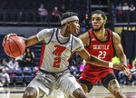 Mississippi guard Devontae Shuler (2) is defended by Seattle guard Terrell Brown (23) during an NCAA college basketball game Tuesday, Nov. 19, 2019, in Oxford, Miss. (Bruce Newman/The Oxford Eagle via AP)