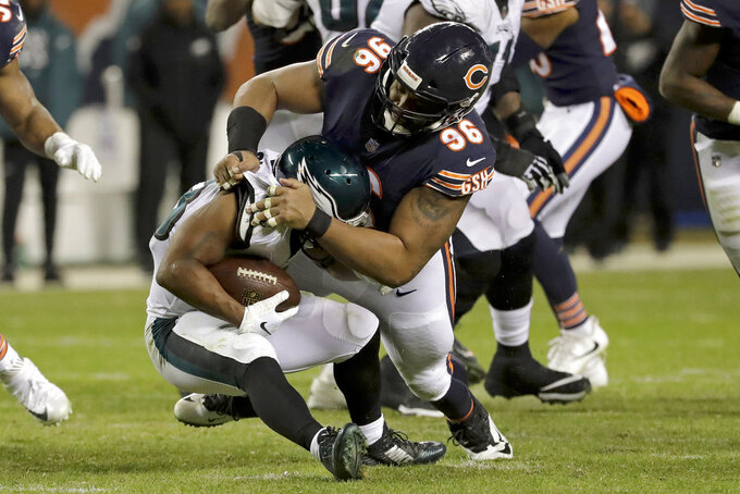 Chicago Bears defensive end Akiem Hicks (96) tackles Philadelphia Eagles running back Darren Sproles (43) during the second half of an NFL wild-card playoff football game Sunday, Jan. 6, 2019, in Chicago. (AP Photo/Nam Y. Huh)