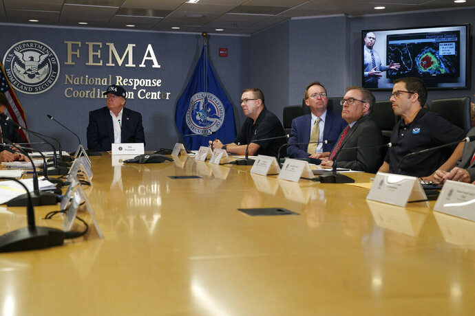 President Donald Trump, left, listens as Kenneth Graham, director of NOAA's National Hurricane Center, on screen, gives an update during a briefing about Hurricane Dorian at the Federal Emergency Management Agency (FEMA), Sunday, Sept. 1, 2019, in Washington, at right of Trump is Acting Administrator Pete Gaynor, Federal Emergency Management Agency, and acting White House chief of staff, Mick Mulvaney, Environmental Protection Agency (EPA) Administrator Andrew Wheeler, and Neil Jacobs, Assistant Secretary of Commerce for Environmental Observation and Prediction. (AP Photo/Jacquelyn Martin)