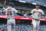 Arizona Diamondbacks' Christian Walker (53) is congratulated by teammate Pavin Smith (26) after scoring against the San Francisco Giants during the fourth inning of a baseball game in San Francisco, Monday, June 14, 2021. (AP Photo/Jeff Chiu)