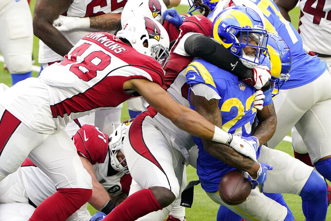Los Angeles Rams running back Cam Akers (23) fumbles the ball, which was recovered by the Arizona Cardinals, during the first half of an NFL football game in Inglewood, Calif., Sunday, Jan. 3, 2021. (AP Photo/Jae C. Hong)