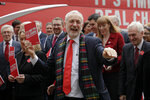 Jeremy Corbyn, Leader of Britain's opposition Labour Party laughs upon arriving for the launch of Labour's General Election manifesto, at Birmingham City University, England, Thursday, Nov. 21, 2019. Britain goes to the polls on Dec. 12. (AP Photo/Kirsty Wigglesworth)