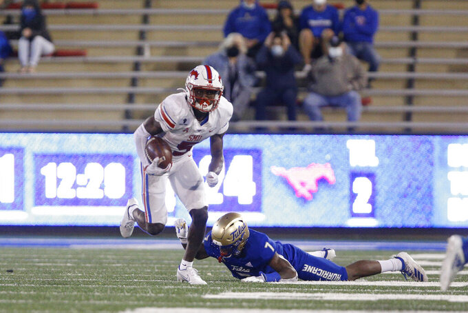 SMU wide receiver Danny Gray (5) makes Tulsa safety TieNeal Martin (7) miss during the second half of an NCAA college football game in Tulsa, Okla., Saturday, Nov. 14, 2020. (AP Photo/Joey Johnson)