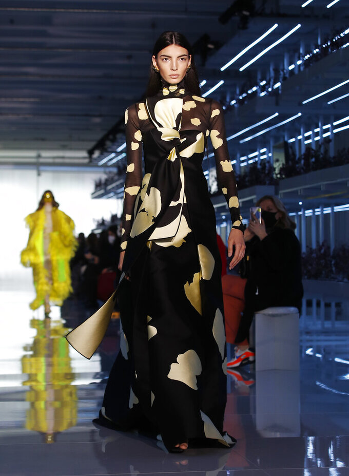 A model wears a creation as part of the Daniel Del Core women's and men's Fall Winter 2021-22 collection, unveiled during the Fashion Week in Milan, Italy, Wednesday, Feb. 24, 2021. (AP Photo/Antonio Calanni)