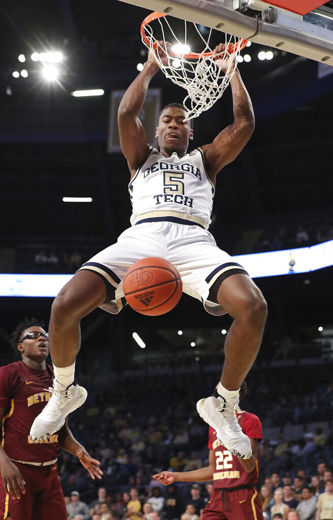 Georgia Tech forward Moses Wright (5) slams for two points over Bethune-Cookman defenders Wali Parks, left,and Isaiah Bailey during an NCAA college basketball game Sunday, Dec. 1, 2019, in Atlanta. (Curtis Compton/Atlanta Journal-Constitution via AP)