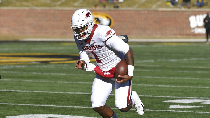 Arkansas quarterback KJ Jefferson runs with the ball during the first half of an NCAA college football game against Missouri Saturday, Dec. 5, 2020, in Columbia, Mo. (AP Photo/L.G. Patterson)