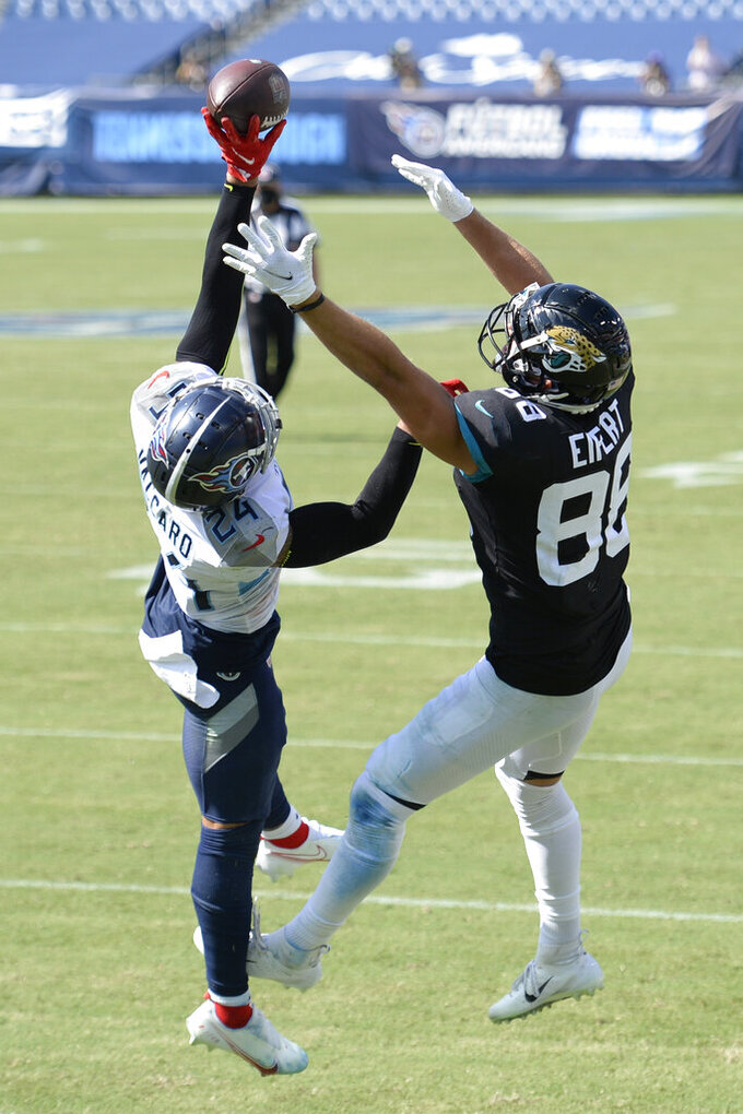 Tennessee Titans strong safety Kenny Vaccaro (24) breaks up a pass intended for Jacksonville Jaguars tight end Tyler Eifert (88) in the second half of an NFL football game Sunday, Sept. 20, 2020, in Nashville, Tenn. (AP Photo/Mark Zaleski)