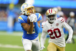 Los Angeles Chargers wide receiver Jalen Guyton (15) makes a catch in front of San Francisco 49ers cornerback Jimmie Ward during the first half of a preseason NFL football game Sunday, Aug. 22, 2021, in Inglewood, Calif. (AP Photo/Jae C. Hong)