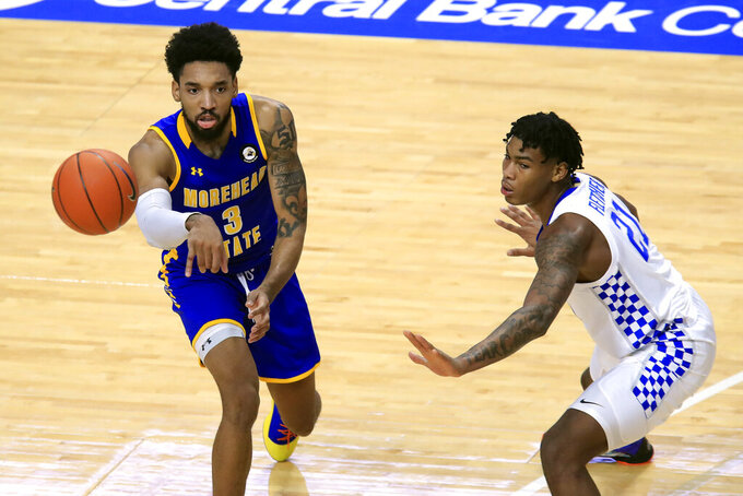 Morehead State's James Baker, left, passes the ball away from Kentucky's Cam'Ron Fletcher during the first half of an NCAA college basketball game in Lexington, Ky., Wednesday, Nov. 25, 2020. (AP Photo/James Crisp)