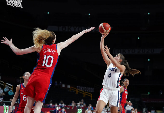 France's Marine Fauthoux (4) shoots over United States' Breanna Stewart (10) during women's basketball preliminary round game at the 2020 Summer Olympics, Monday, Aug. 2, 2021, in Saitama, Japan. (AP Photo/Charlie Neibergall)