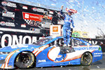 Kyle Larson stands atop his car after winning a NASCAR Cup Series race, Sunday, June 6, 2021, at Sonoma Raceway in Sonoma, Calif. (AP Photo/D. Ross Cameron)