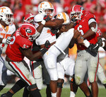 Georgia defenders, Tyler Clark, left, and Natrez Patrick, right, wrap up Tennessee running back Jeremy Banks at the line of scrimmage during the second half in an NCAA college football game Saturday, Sept 29, 2018, in Athens. (Curtis Compton/Atlanta Journal-Constitution via AP)