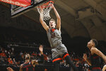 Oregon State's Kylor Kelley (24) dunks over Stanford's Bryce Wills (2) and Oscar da Silva (13) during the first half of an NCAA college basketball game in Corvallis, Ore., Thursday, March 5, 2020. (AP Photo/Amanda Loman)
