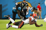 Cleveland Browns wide receiver Donovan Peoples-Jones, right, is stopped after a reception by Jacksonville Jaguars cornerback Shaquill Griffin (26) during the first half of an NFL preseason football game, Saturday, Aug. 14, 2021, in Jacksonville, Fla. (AP Photo/Stephen B. Morton)