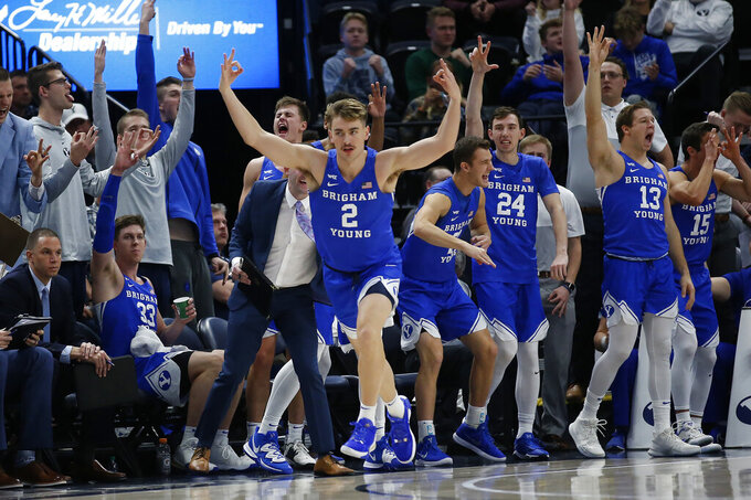 BYU guard Zac Seljaas (2) celebrates after making a three-point basket against Utah State in the second half during an NCAA college basketball game Saturday, Dec. 14, 2019, in Salt Lake City. (AP Photo/Rick Bowmer)