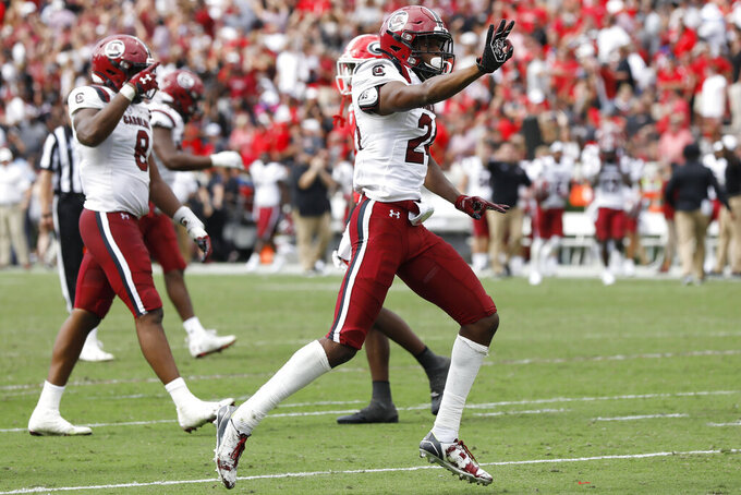South Carolina defensive back Israel Mukuamu (24) celebrates his third interception of the game in overtime of a NCAA football game between Georgia and South Carolina in Athens, Ga., on Saturday, Oct. 12, 2019. South Carolina won 20-17 in double overtime. (Joshua L. Jones/Athens Banner-Herald via AP)