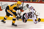 Pittsburgh Penguins' Marcus Pettersson (28) checks Chicago Blackhawks' Alex Nylander (92) off the puck during the first period of an NHL hockey game in Pittsburgh, Saturday, Nov. 9, 2019. (AP Photo/Gene J. Puskar)